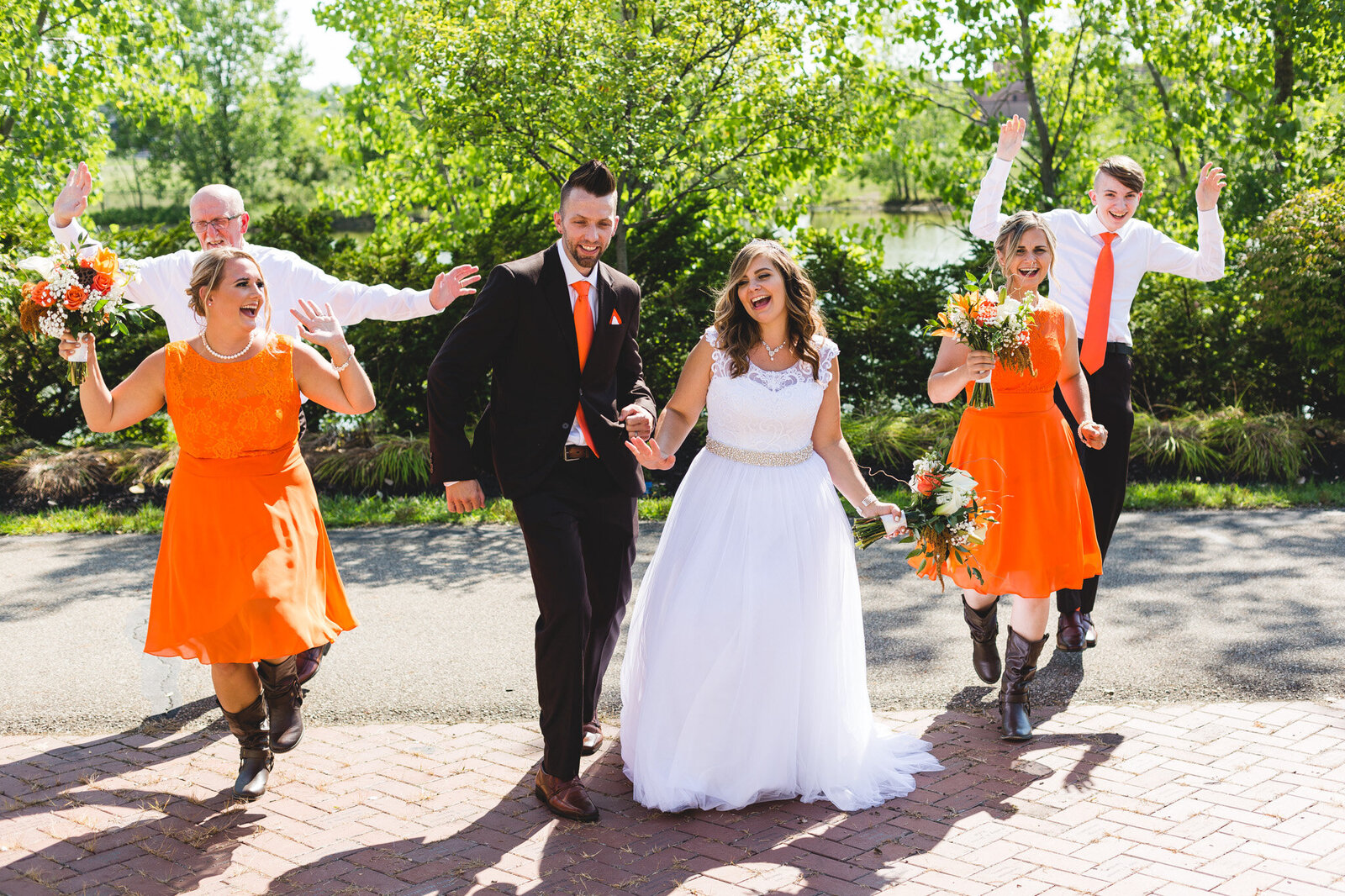 bridal party dancing in orange during portraits ohio wedding