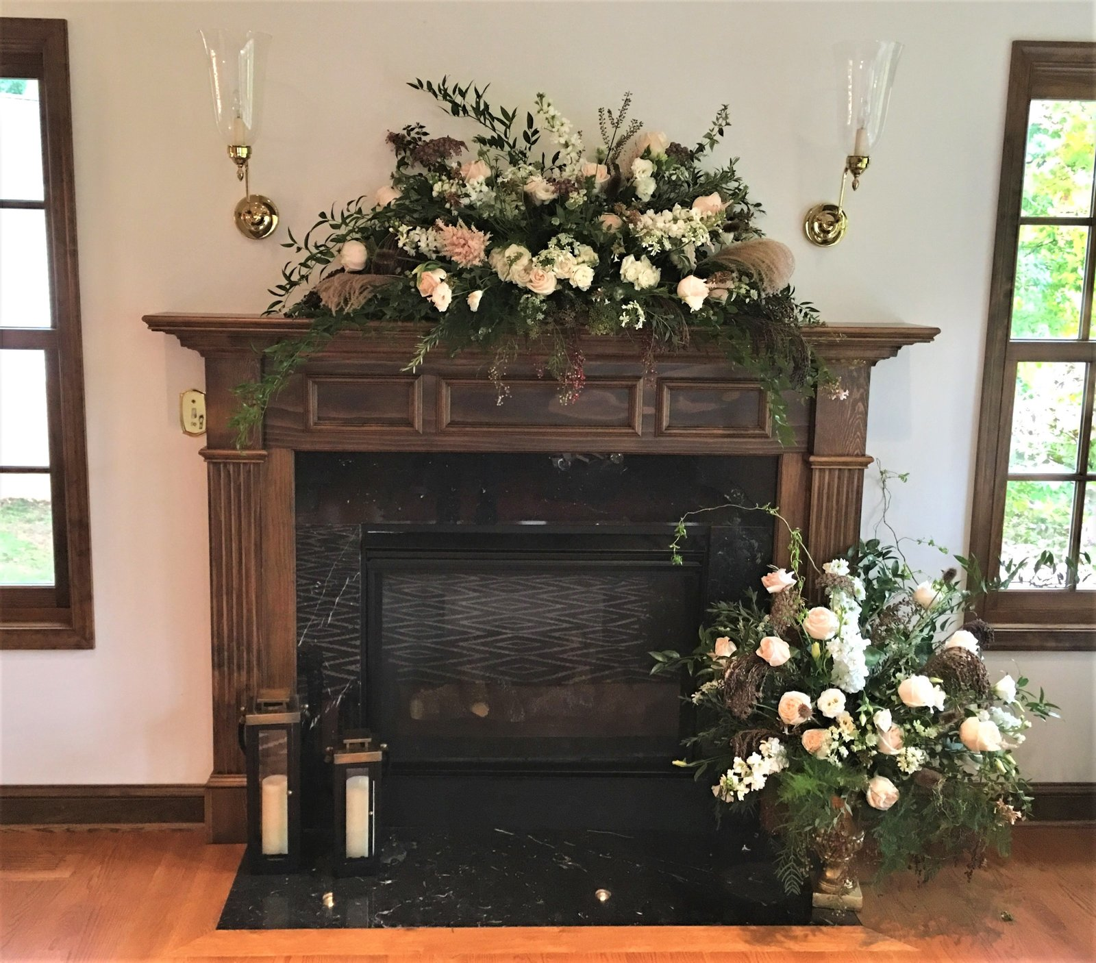 Mantel and fireplace floral decor for wedding in a home in Vienna, VA