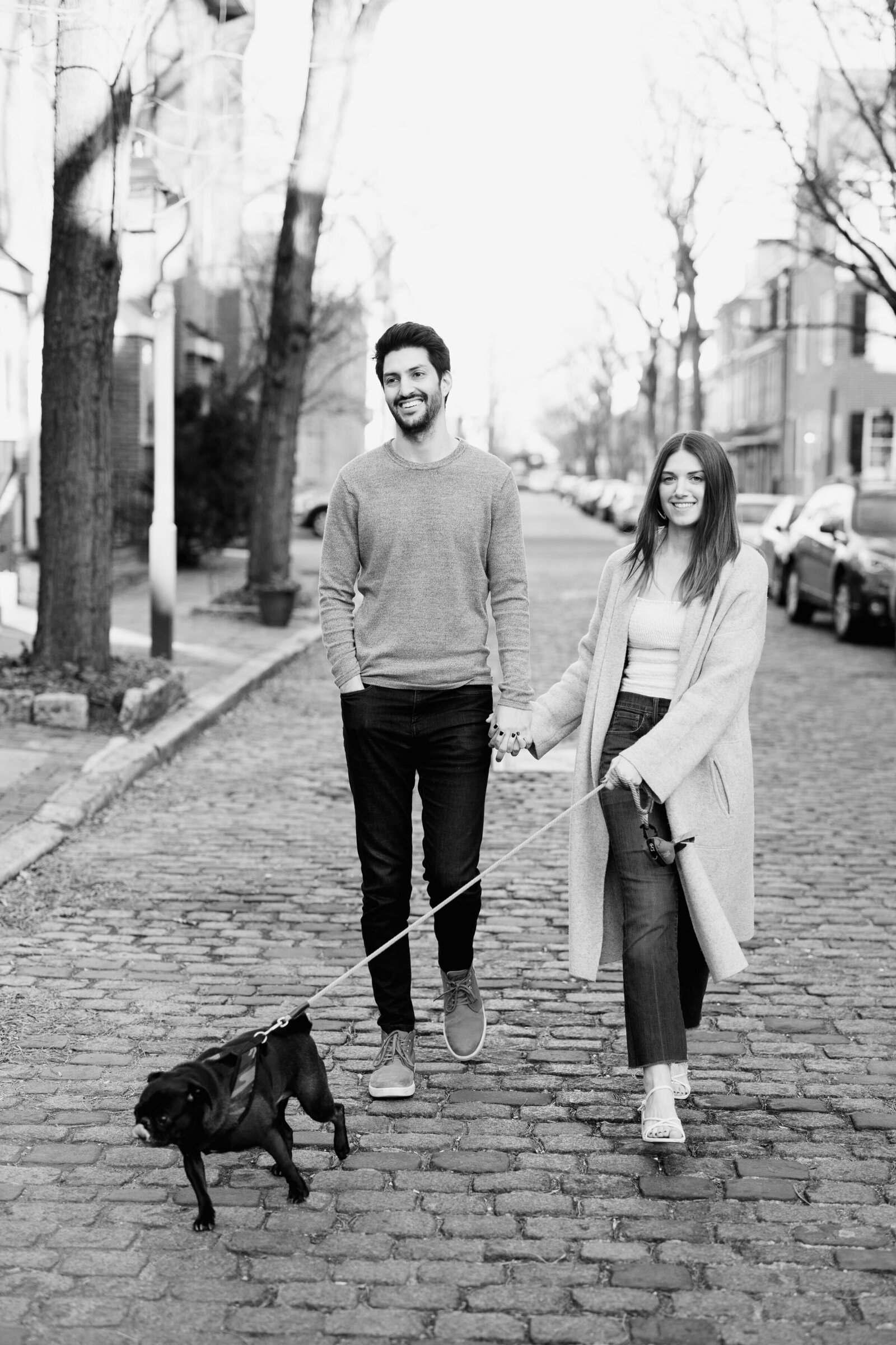 couple in city street with dog