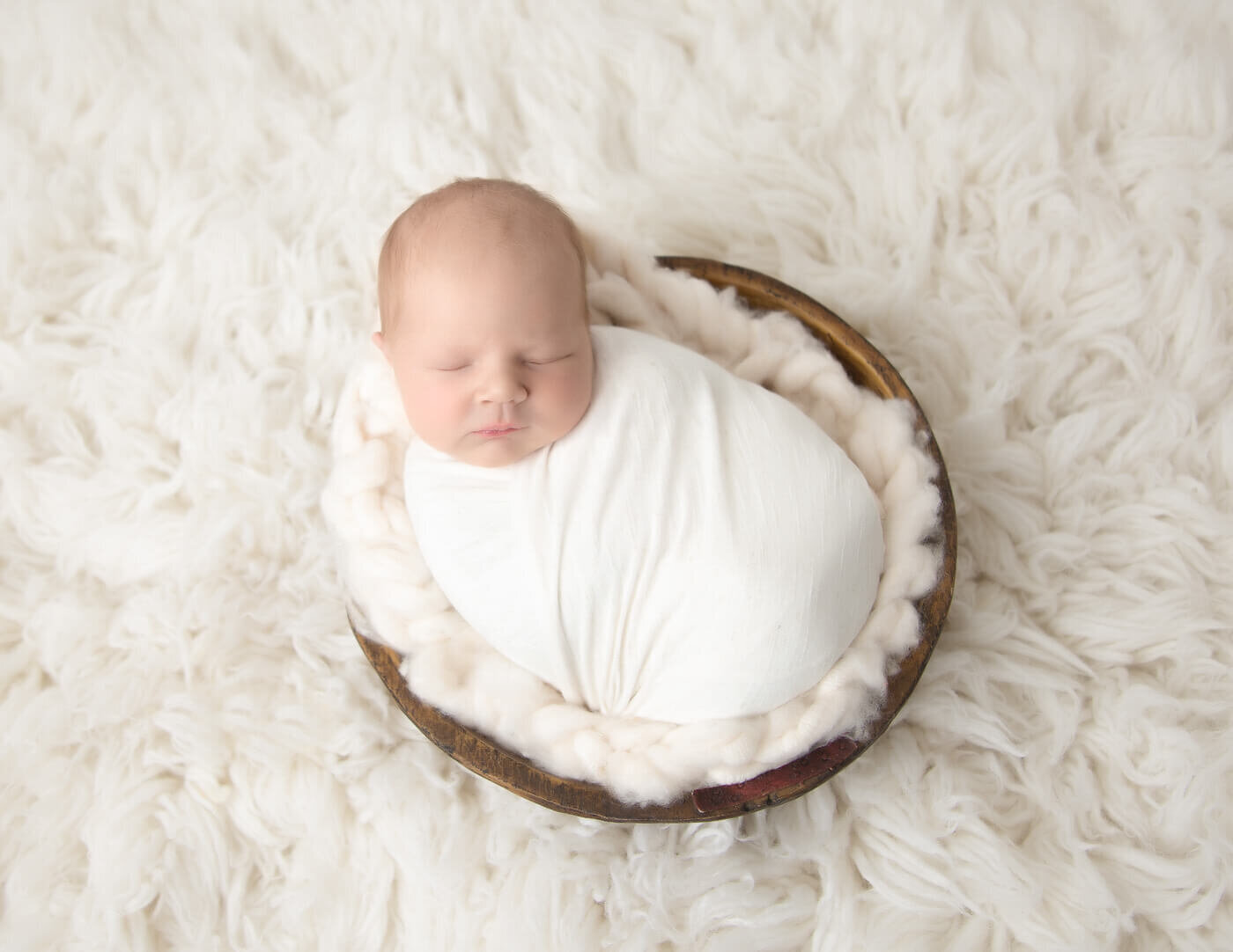 Little newborn boy at our in-home studio in Rochester, NY.