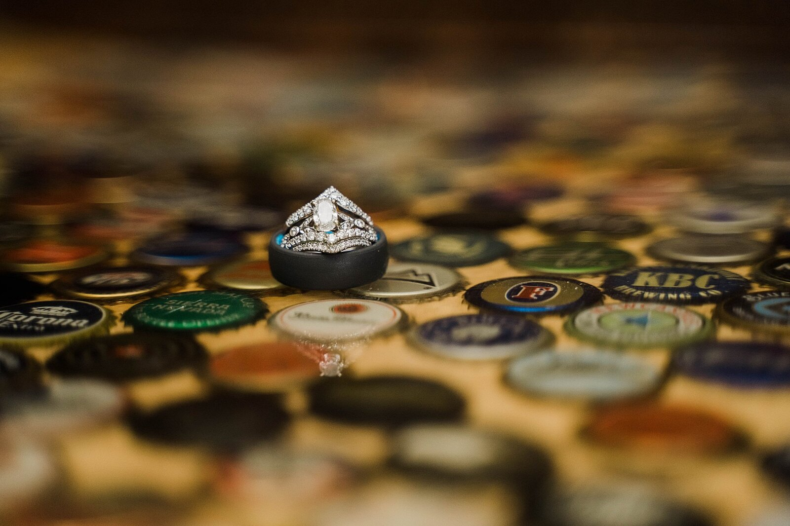 Wedding ring detail photo on beer caps