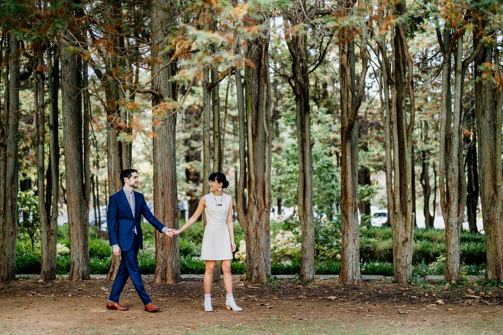 bride in short dress with groom in woods
