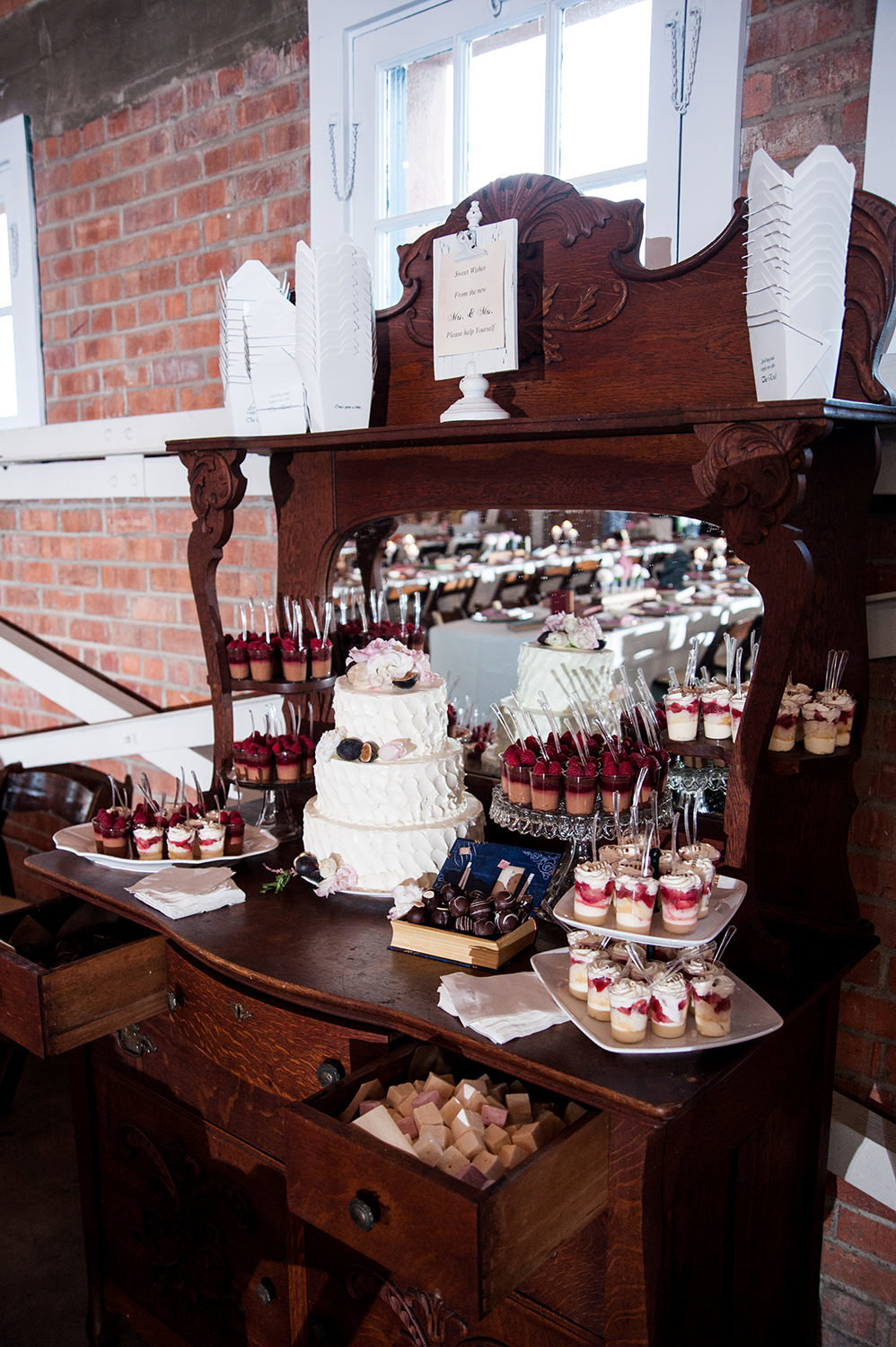 beautiful photo of reception room at brick cake table