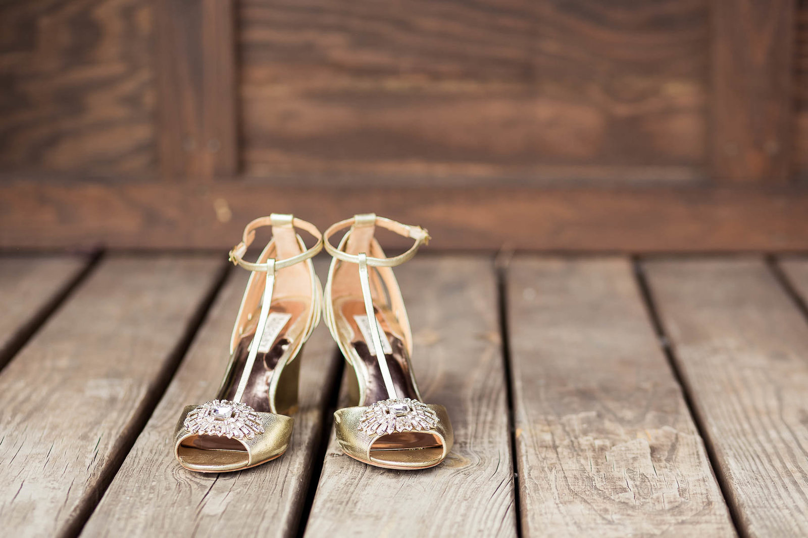 Bride's shoes sit on wooden floor, Boals Farm, Charleston, South Carolina