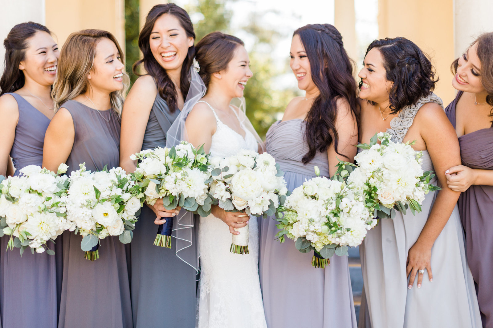 purple bridesmaid dresses white bouquets