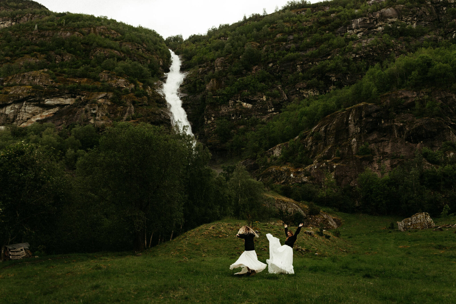 brides in norway at waterfall running around