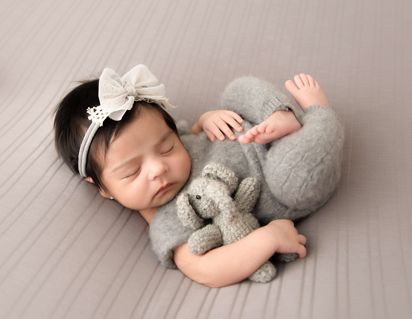 Sleeping newborn posed at our studio located in Rochester, NY.