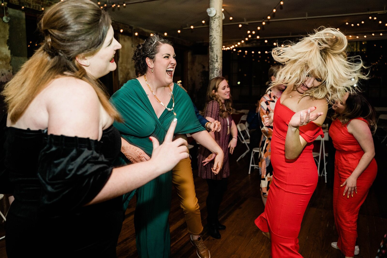 Wedding guest dances with bride at the bauer event space
