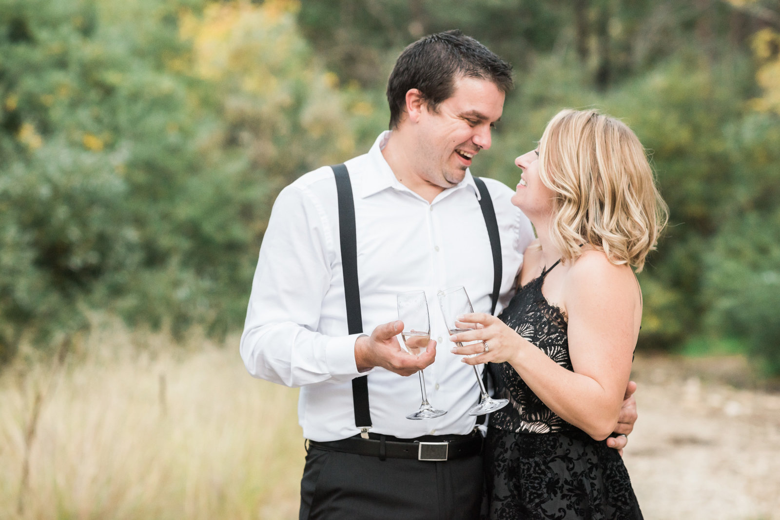 Mt Lemmon Classy and Stylish Engagement Session Photo of Engaged Couple and Champagne Glasses Toasting | Tucson Wedding Photographer | West End Photography