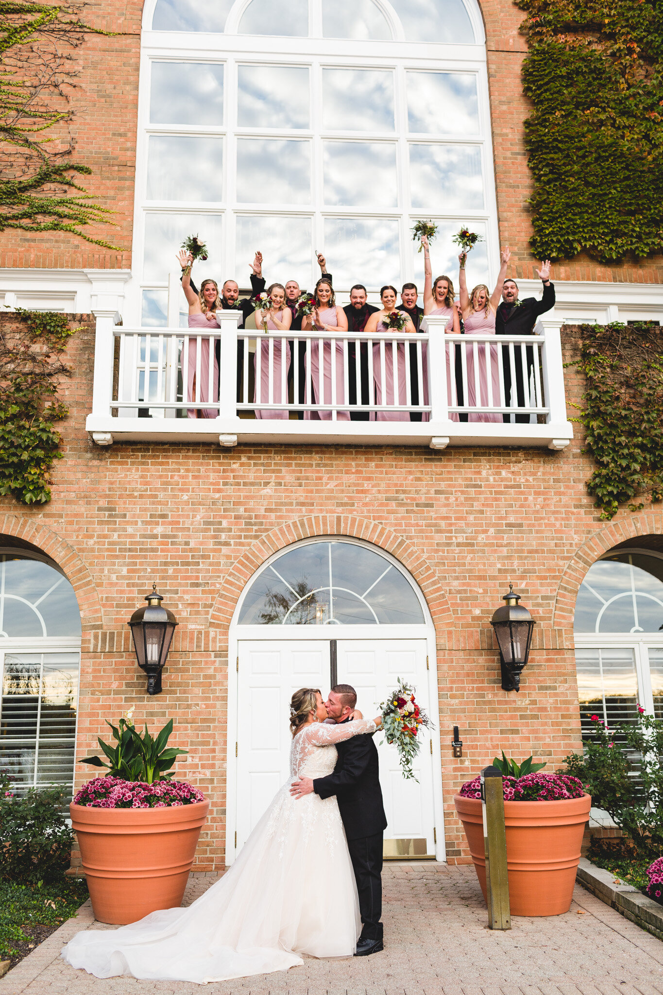 bridal party cheering as couple kisses ohio wedding photographer