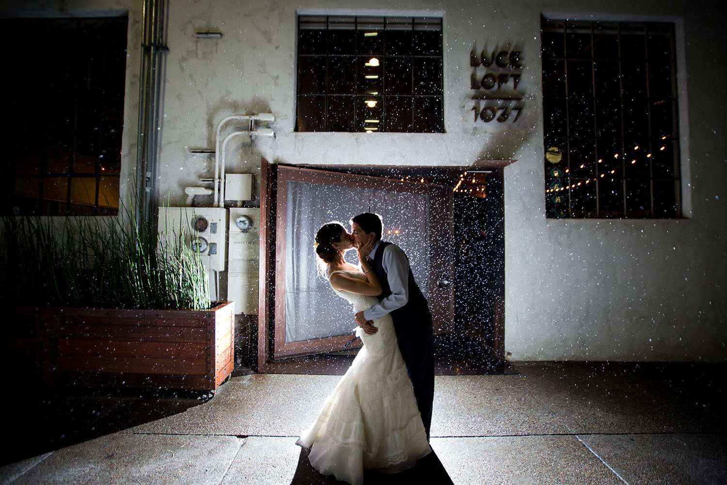 night image of bride and groom in front of luce loft