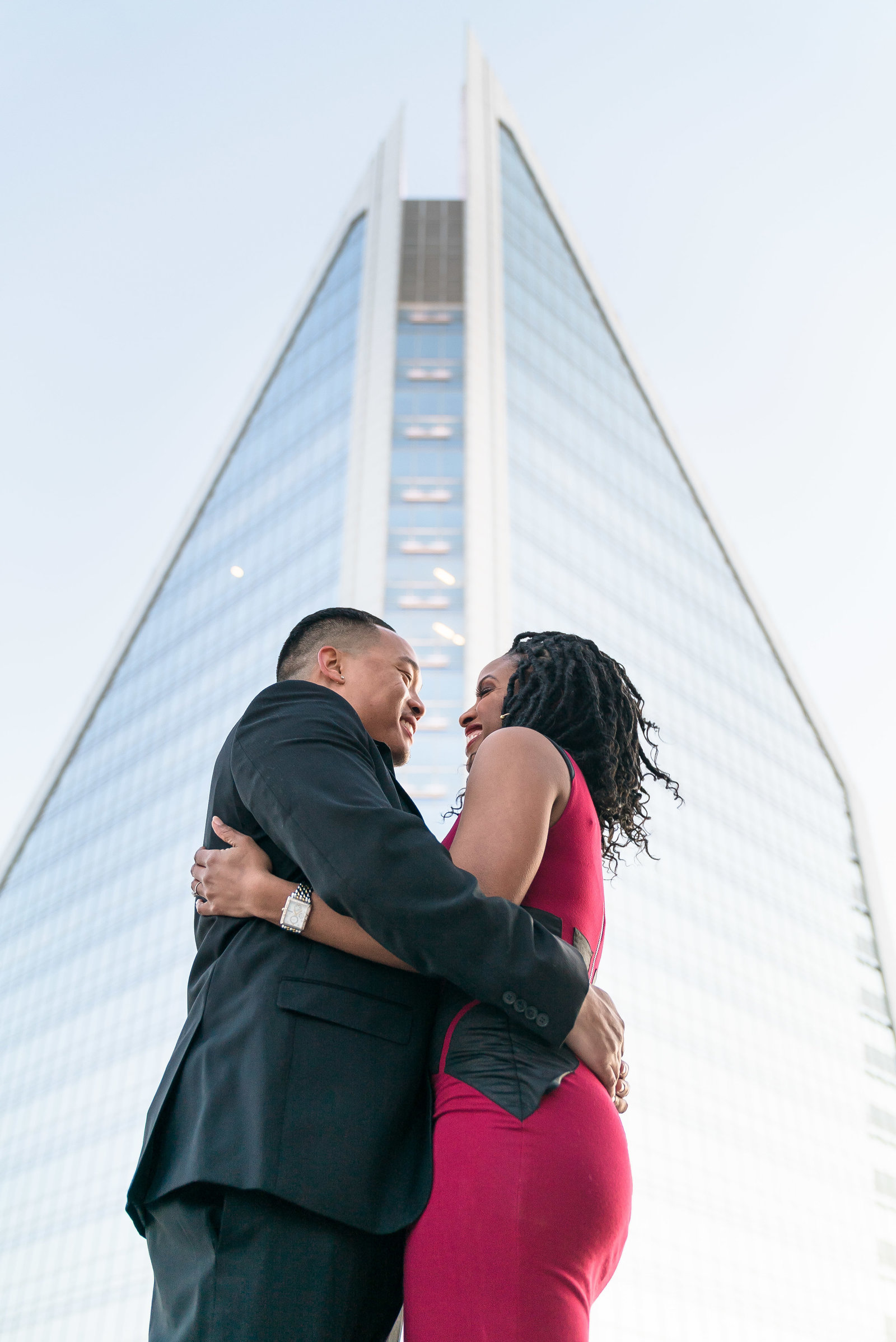 Charlotte engagement photographer shot of Duke energy building in uptown charlotte