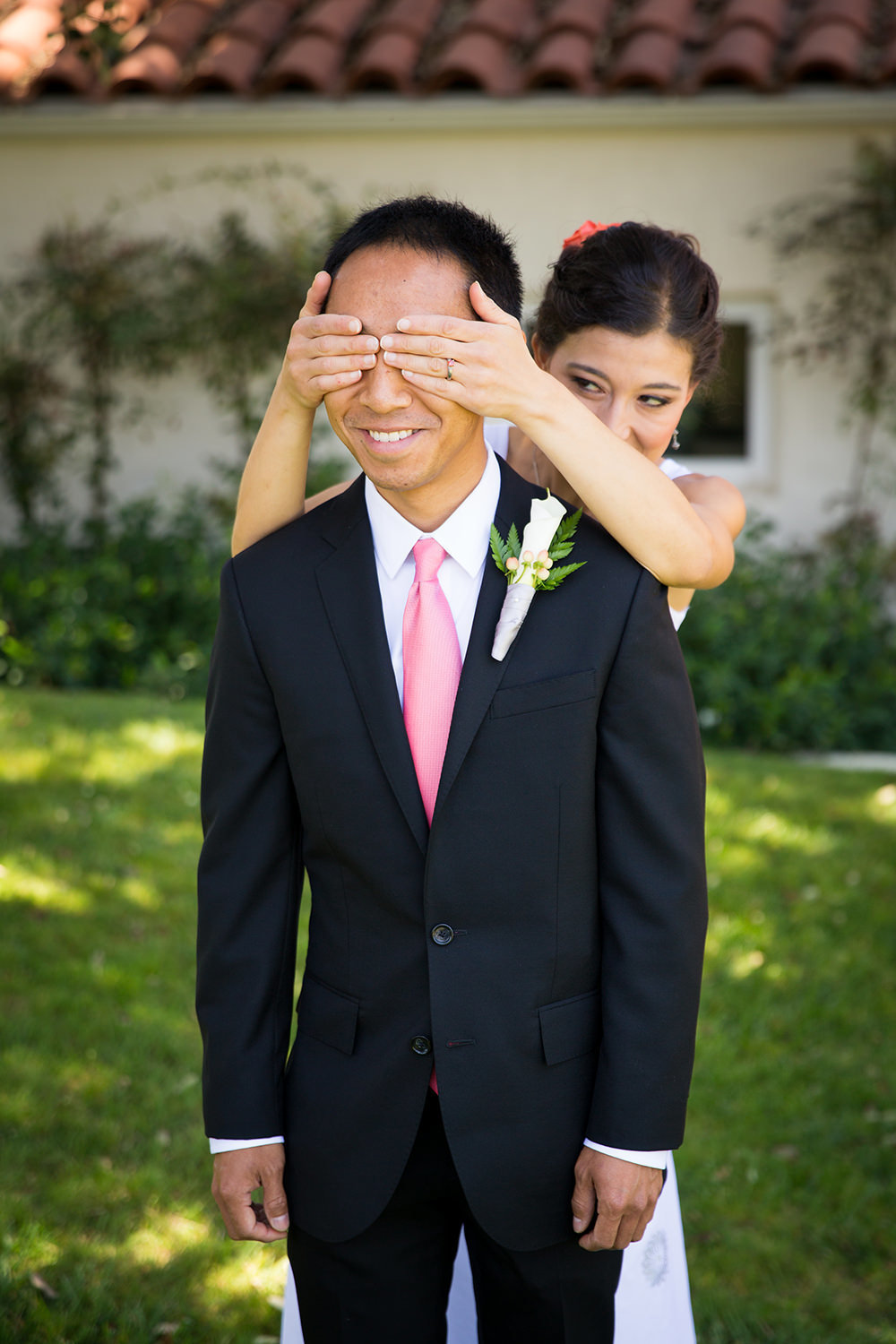 bride covering grooms eyes first look