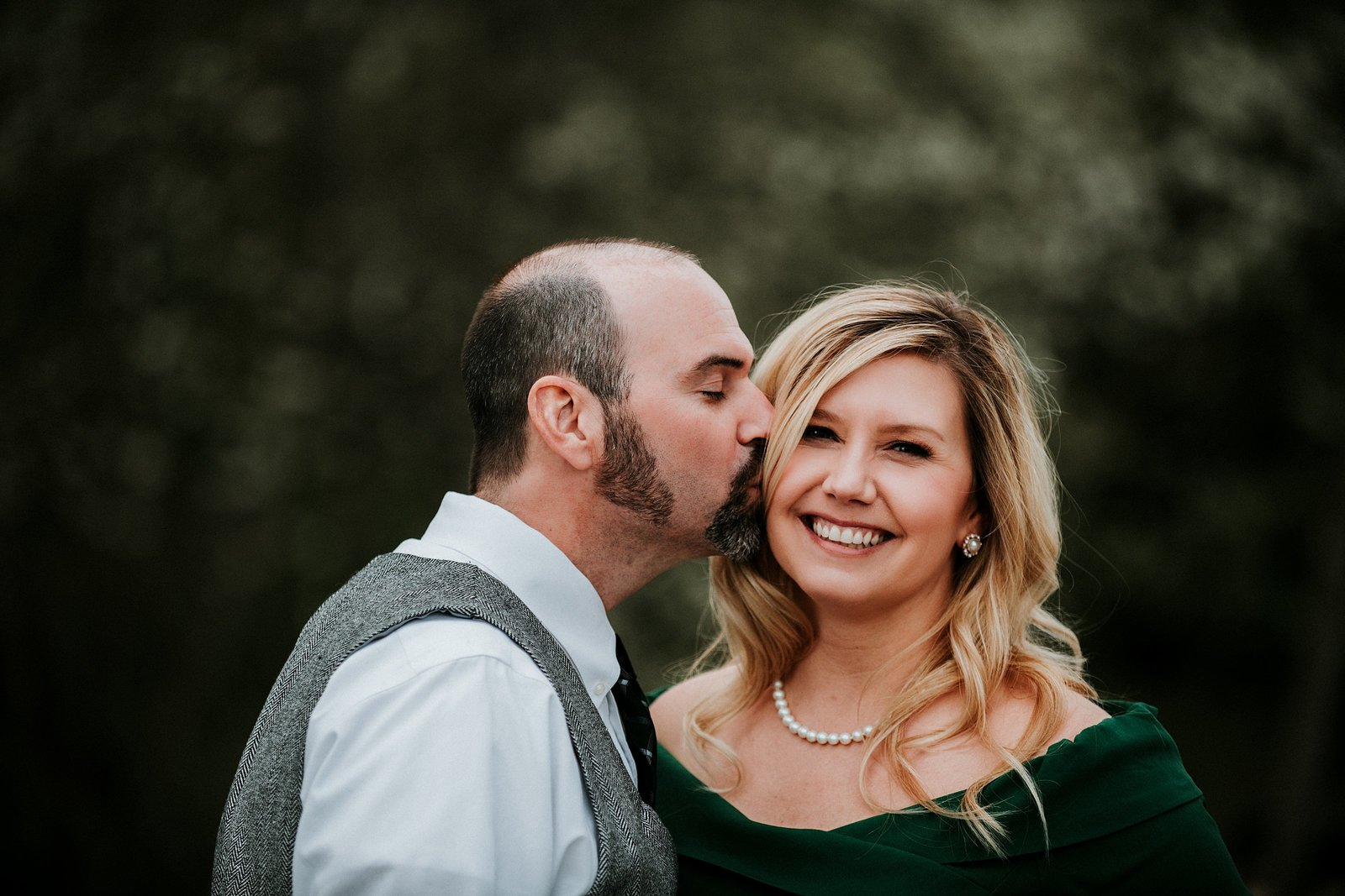 Man kissing womans cheek by Ellensburg Engagement Photographer