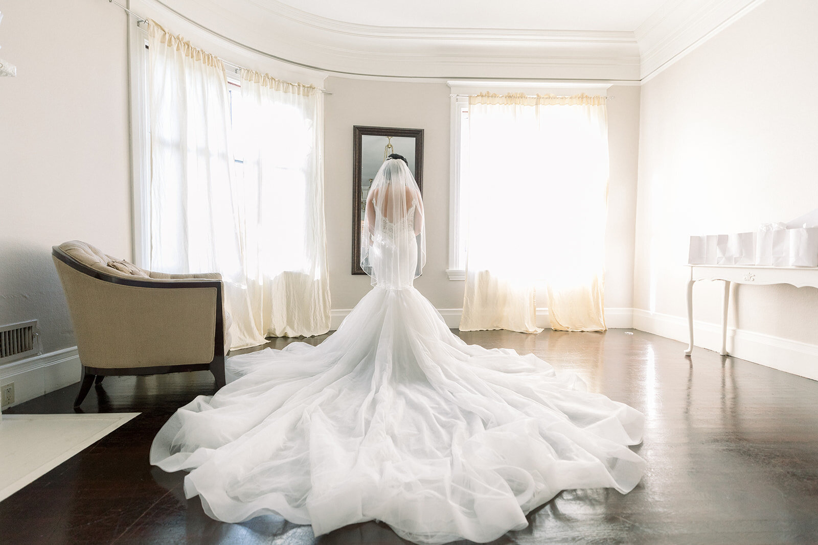 Bride's cascading train spills over the hardwood of the Bridal Suite on her big day.