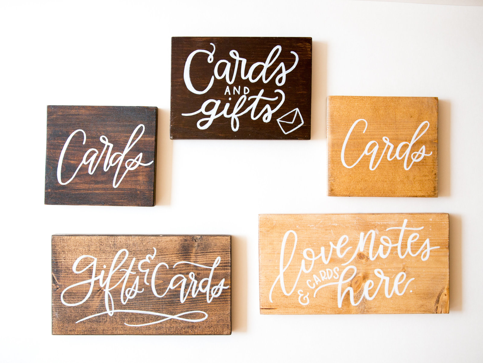 wooden signage with white calligraphy for wedding and events with Hue + FA Rentals