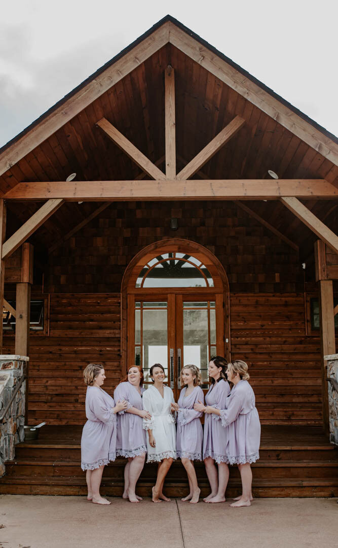 Bridesmaids together before wedding in Boone NC