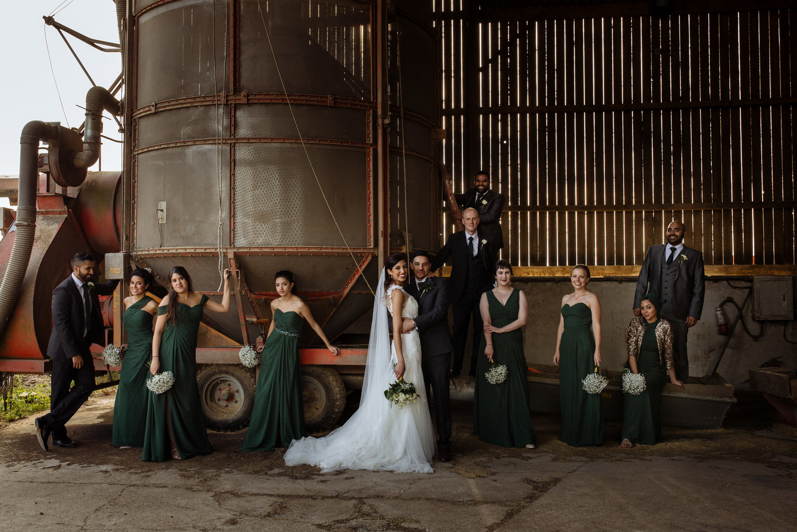 Bridal party in barn at The Normans Wedding Venue. Yorkshire wedding photographer