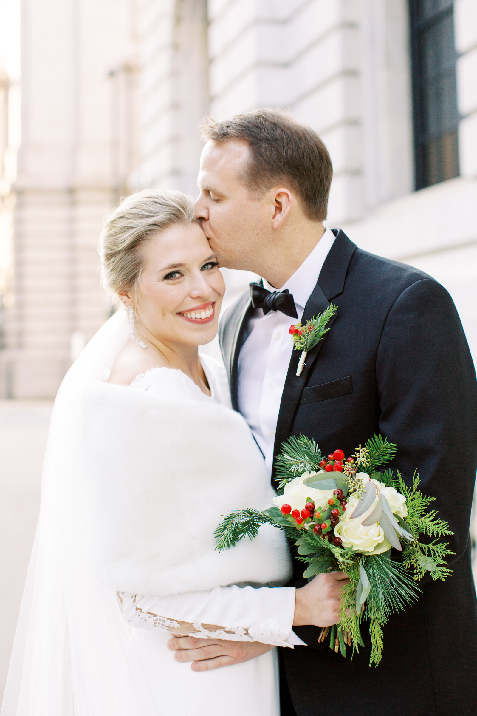 couple winter wedding portrait outside of Cleveland Public Library