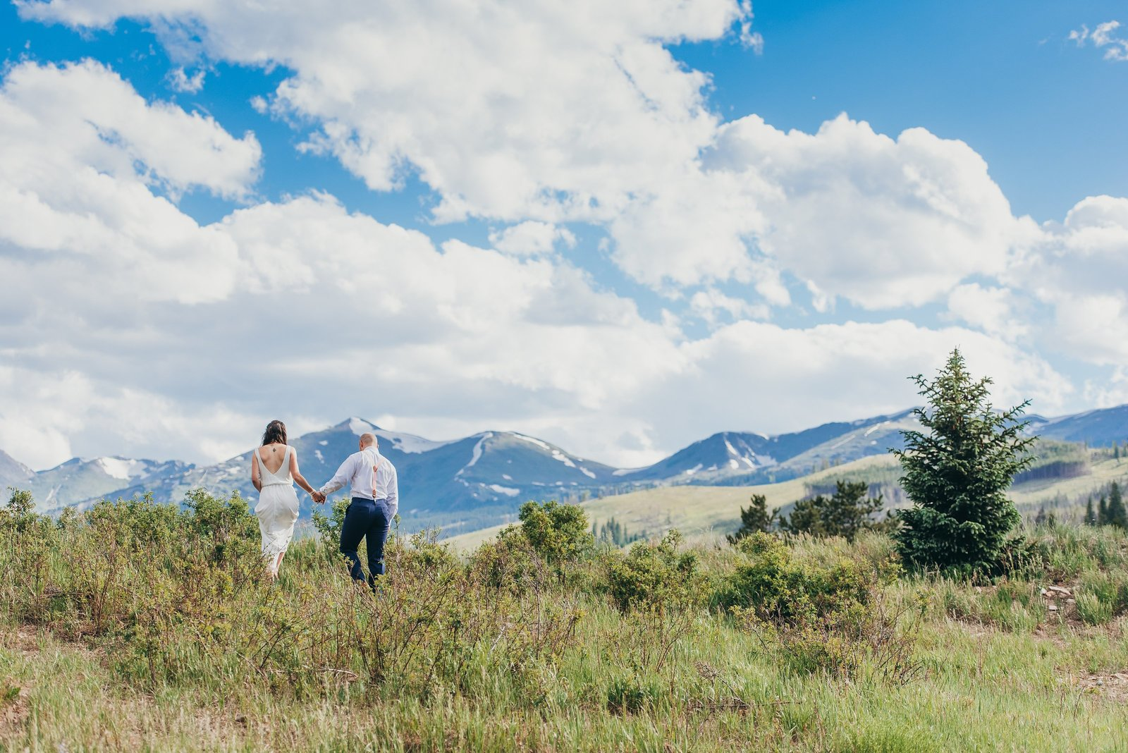 Happy couple in Grand Teton National Park for an adventure engagement session.
