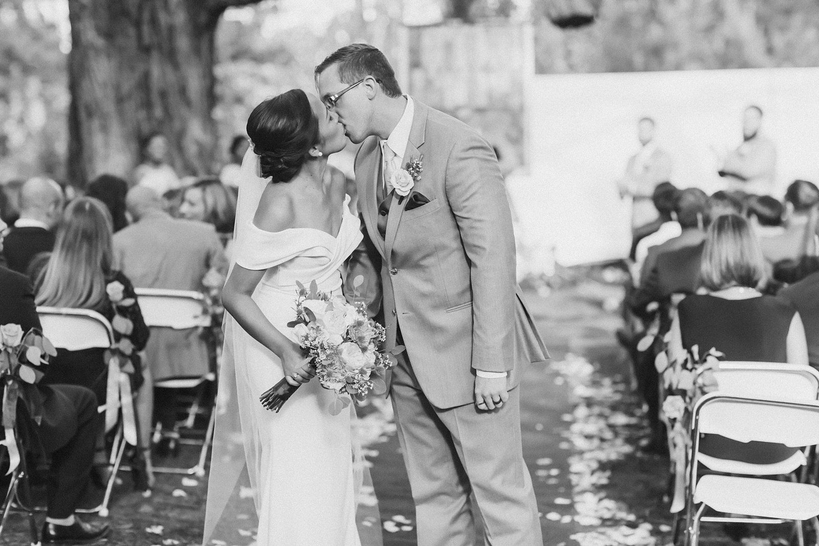 M Harris Studios_Braehead Manor_VA Wedding Photographer_bride groom recessional kiss