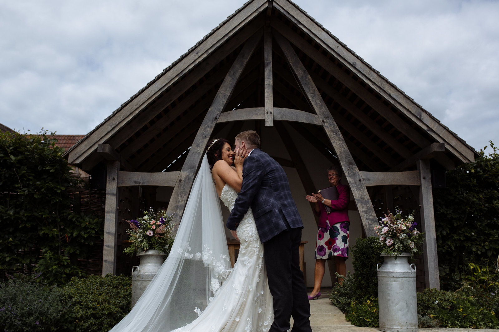 First kiss at Kingscote Barn wedding. Documentary wedding photographer