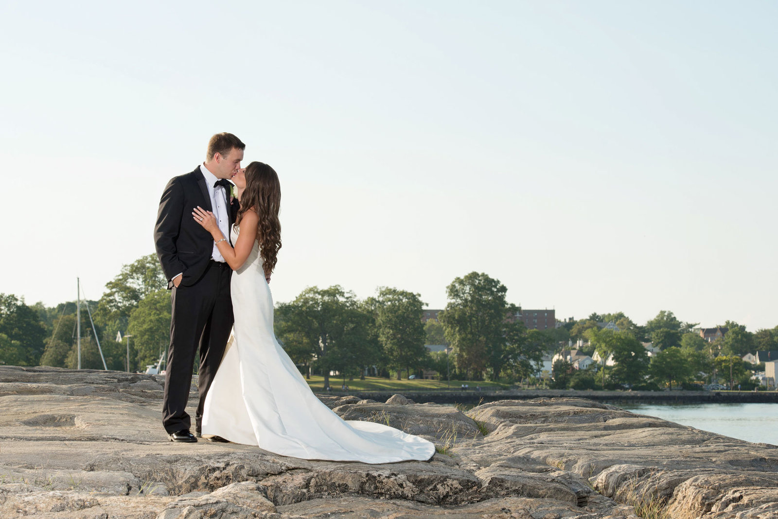bride and groom outside by the water at Glen Island Harbor Club