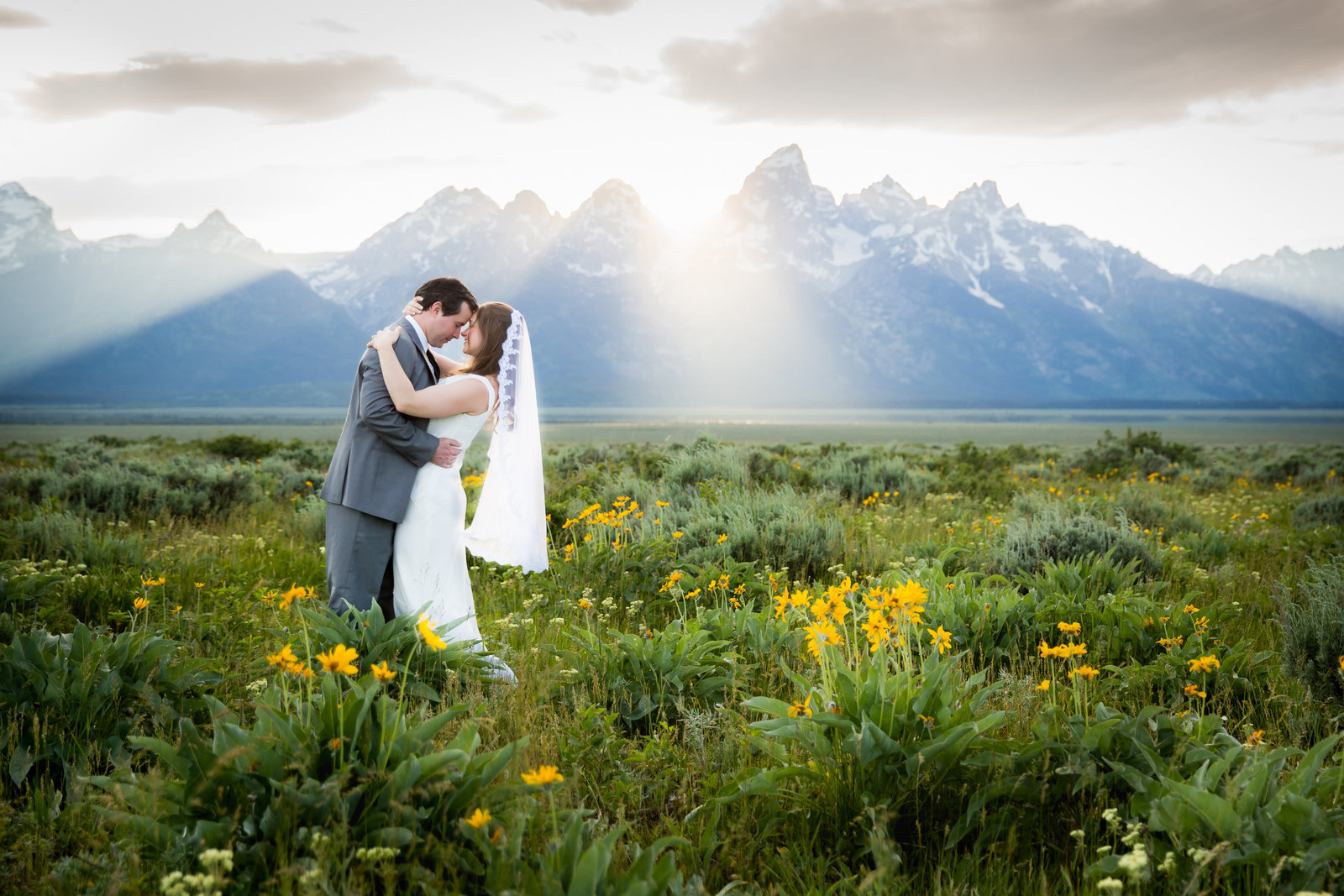 Grand Teton National Park wedding couple in wildflowers at sunset