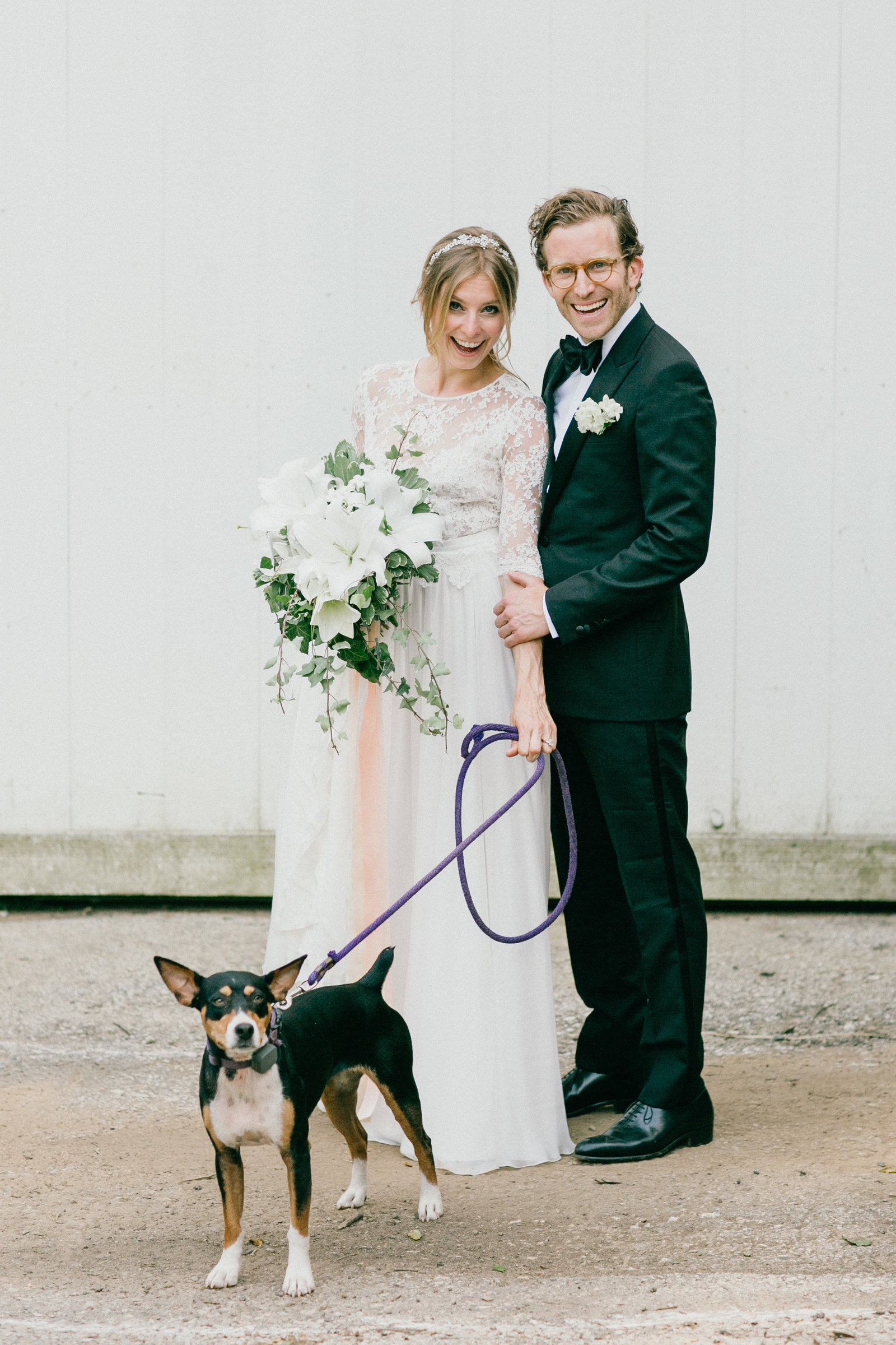 Family portrait of the bride, groom, and favorite furry friend.