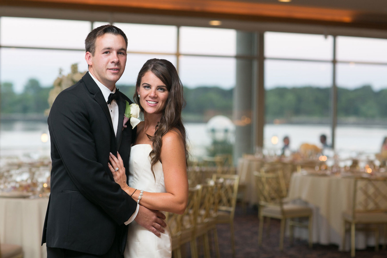 bride and groom standing in the ballroom at Glen Island Harbor Club