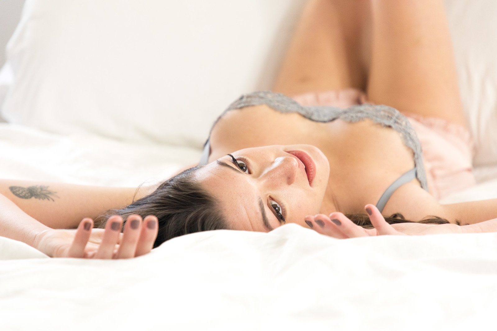 Woman lying on white bed in cute pajamas