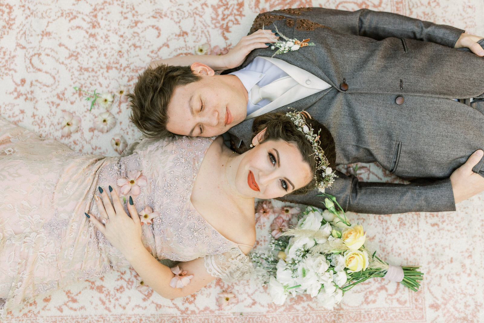 Bride & Groom laying near each other