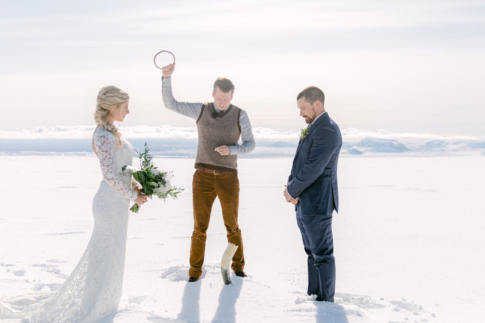 iceland officiating an elopement on top of a glacier with bride and groom