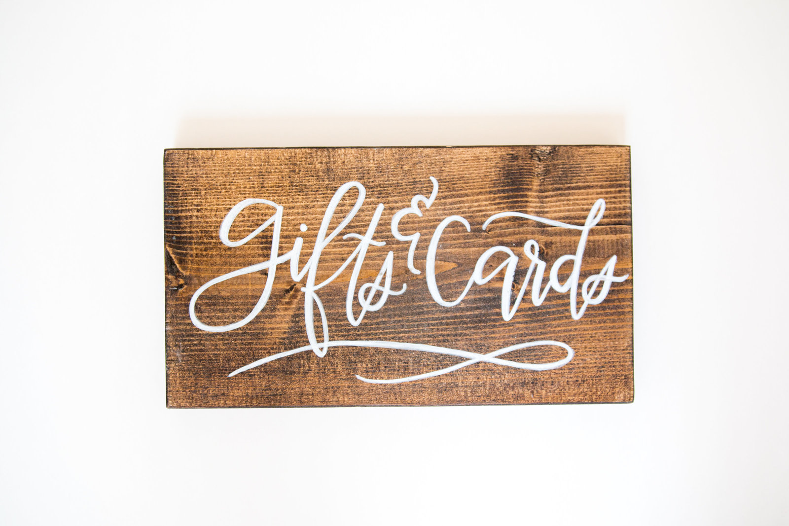 wood sign  with white calligraphy for gifts and cards at weddings and events with Hue and FA Rentals