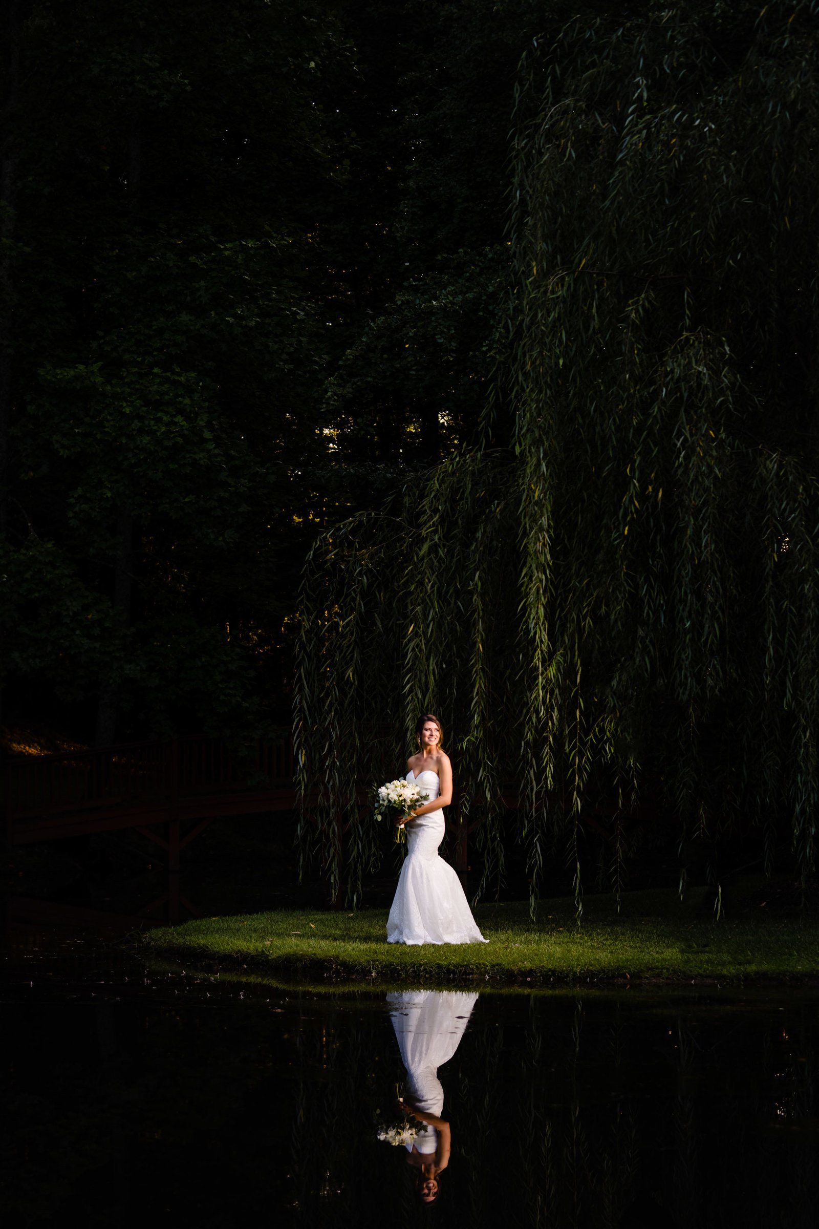 bride standing near lake