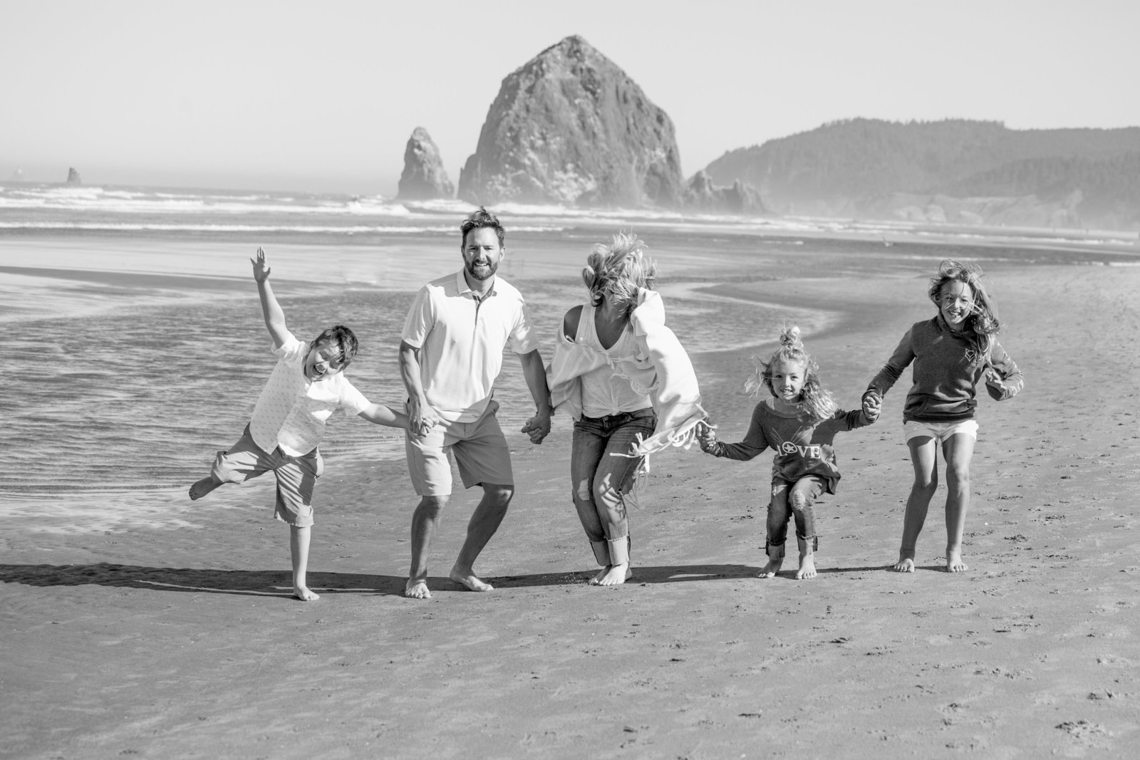 black and white family photo on Cannon Beach