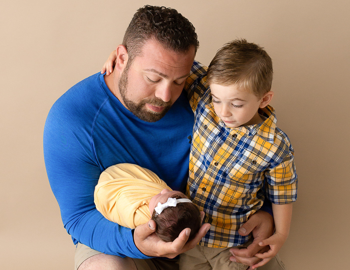 Father, son and newborn daughter in our Rochester NY studio.