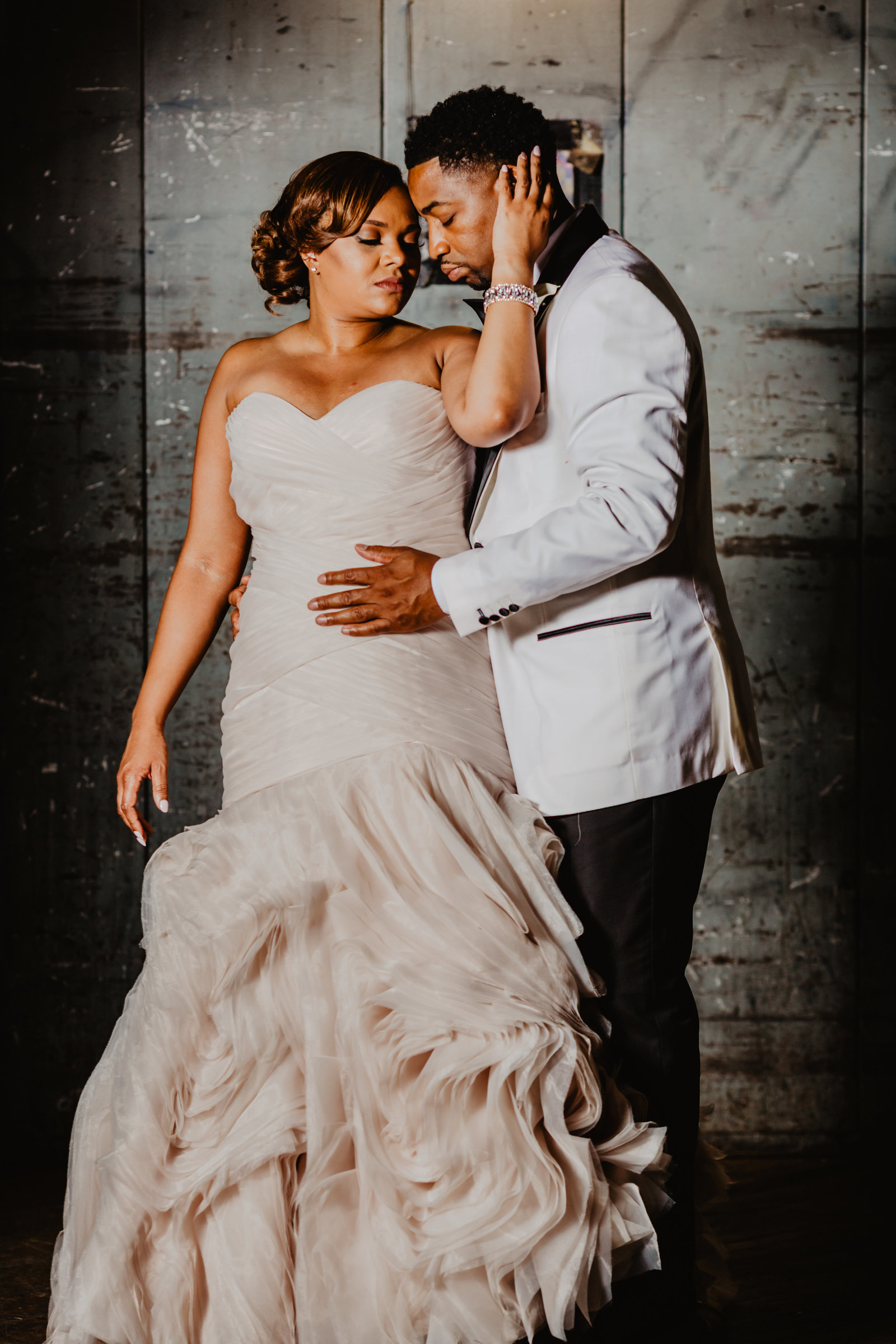Bride and Groom cuddle up in elevator at Cannery Ballroom