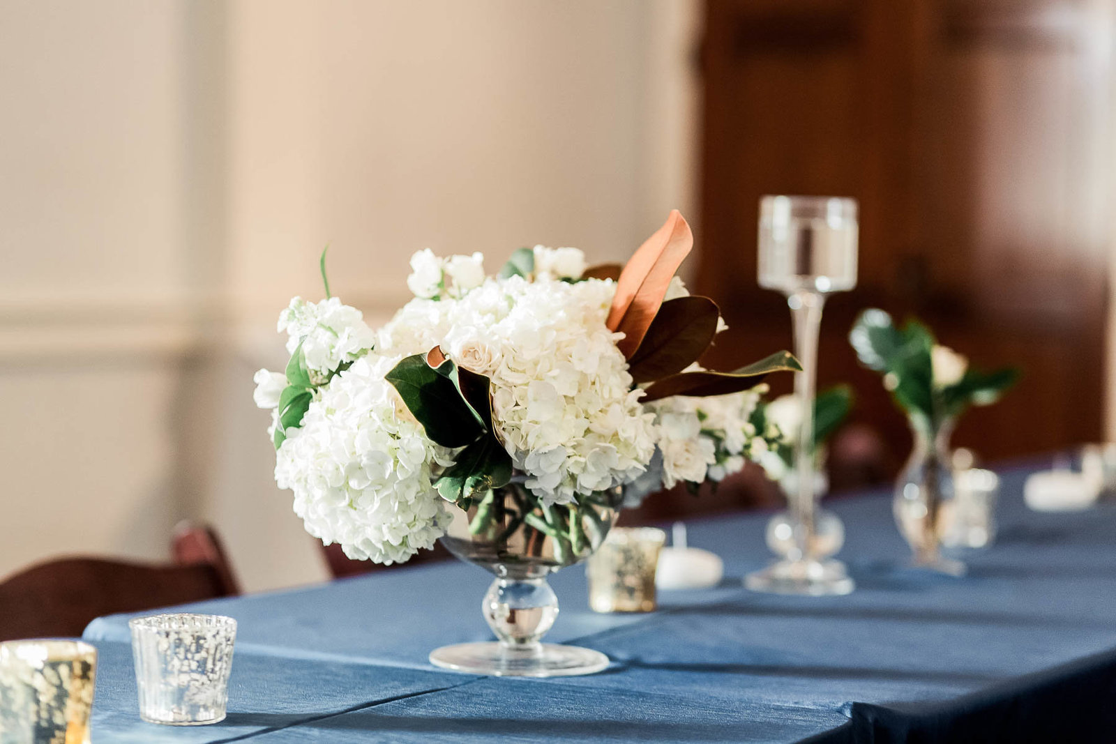 Beautiful floral centerpieces are on each table, Coleman Hall, Charleston Wedding Photographer.