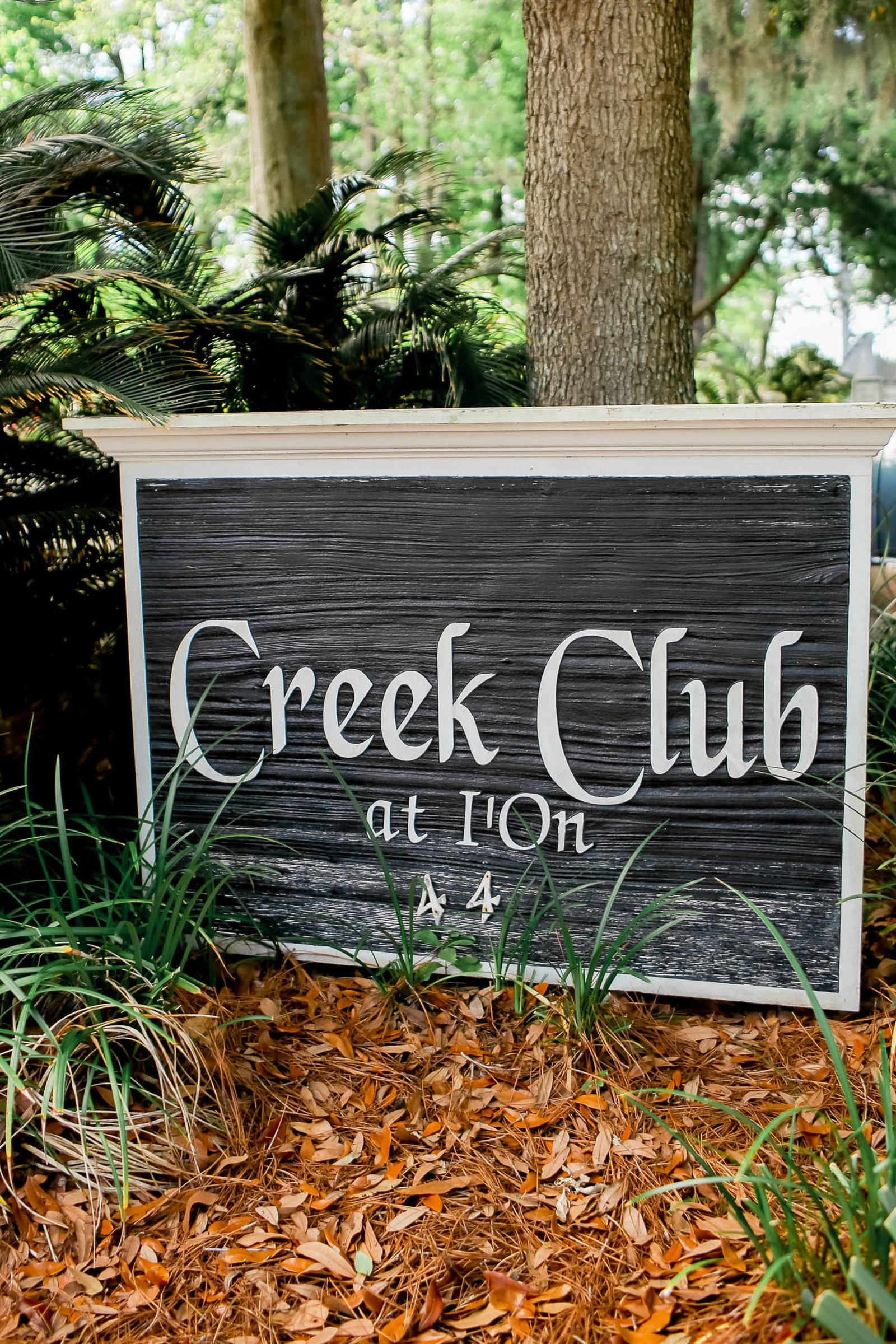Wooden sign is displayed of I'ON Creek Club, Mt Pleasant, South Carolina