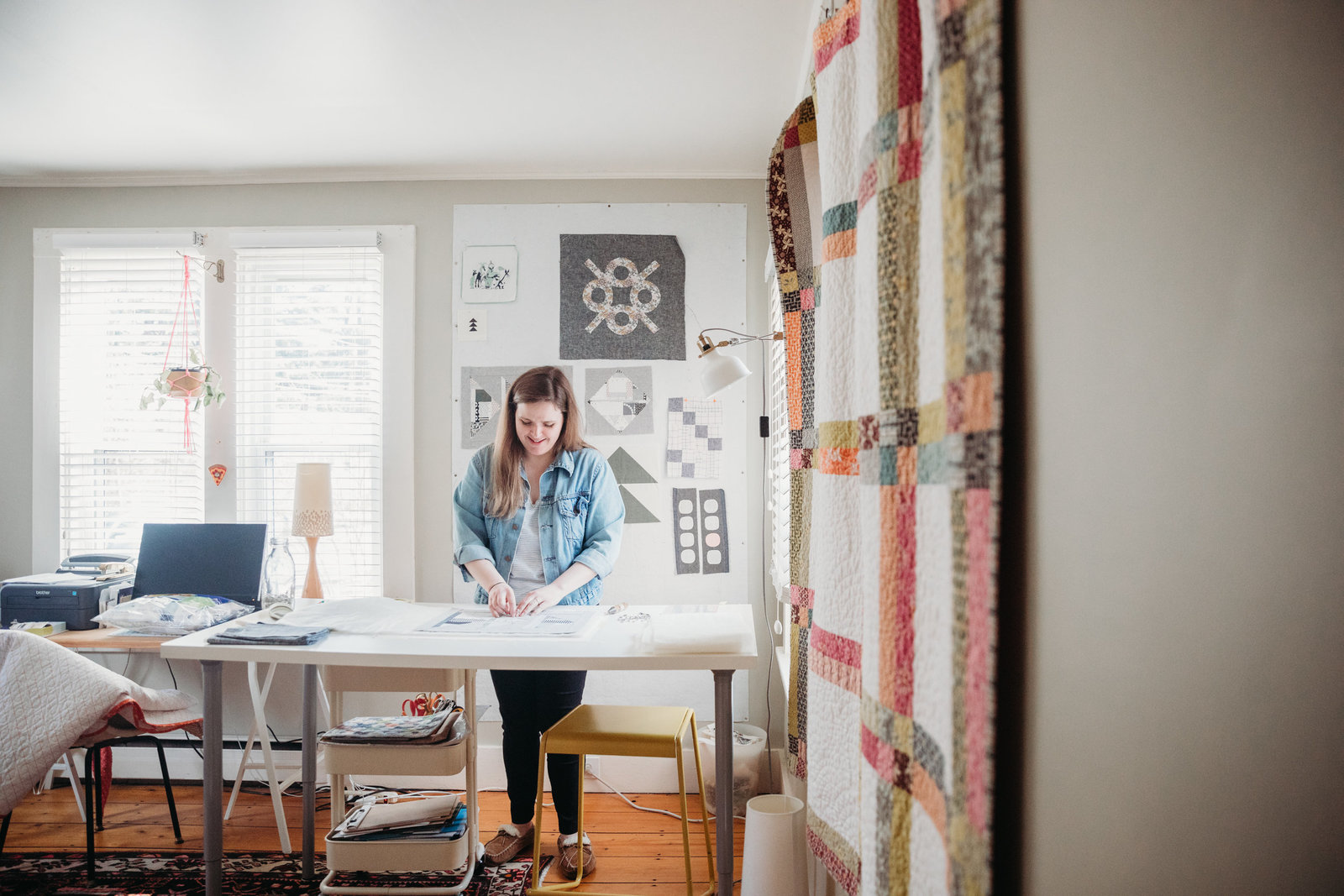 quilter prepares sewing materials in workspace in boston