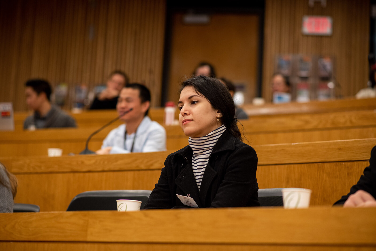 A student at the Harvard T.H. Chan School of Public Health in a lecture hall.