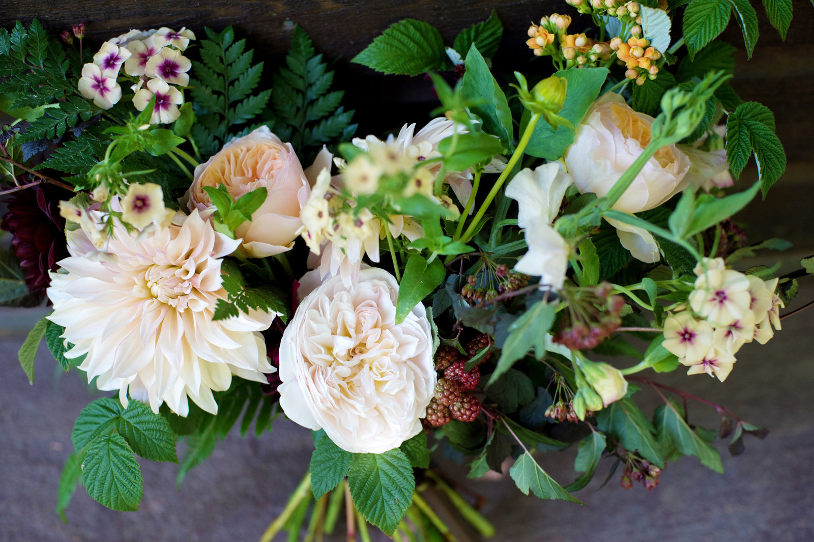an ivory and peach wedding bouquet