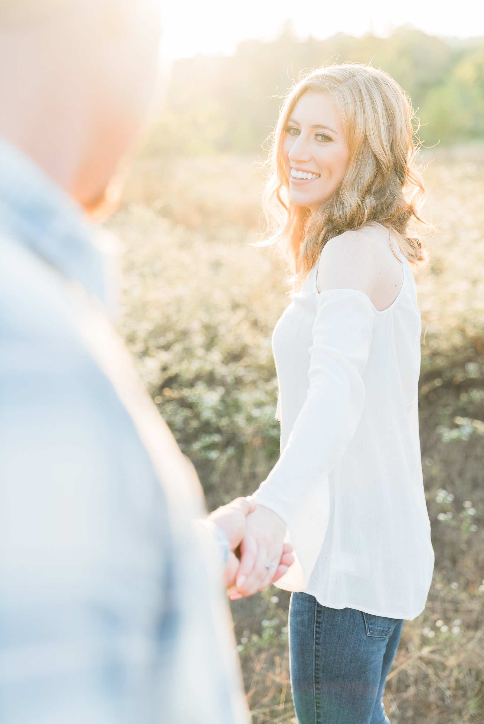 Charlotte engagement photographer shot of couple in field during sunset in south park
