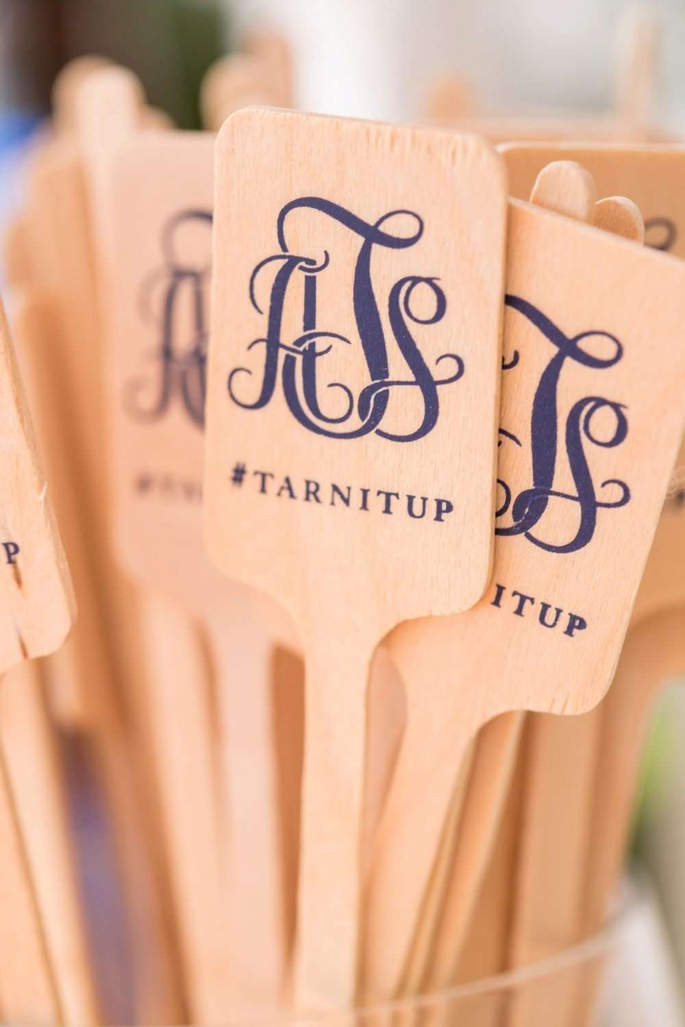 Custom monogrammed wooden drink stirrers for tented wedding at Eisenhower House