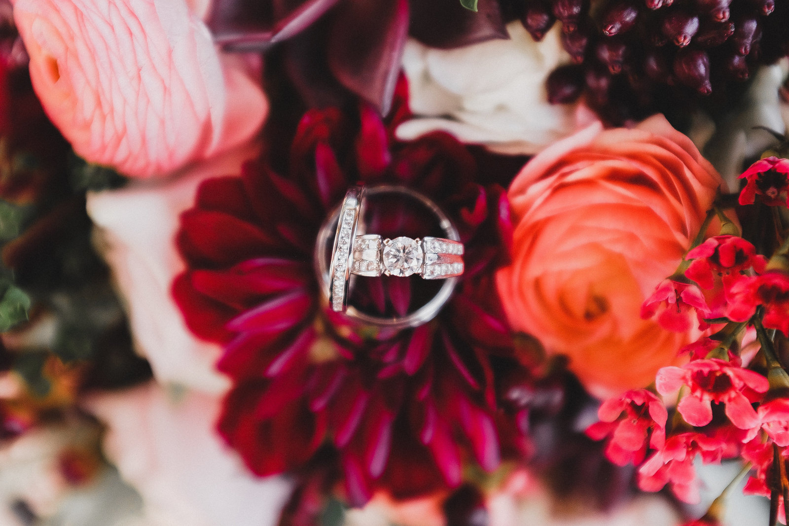 red flowers with wedding rings