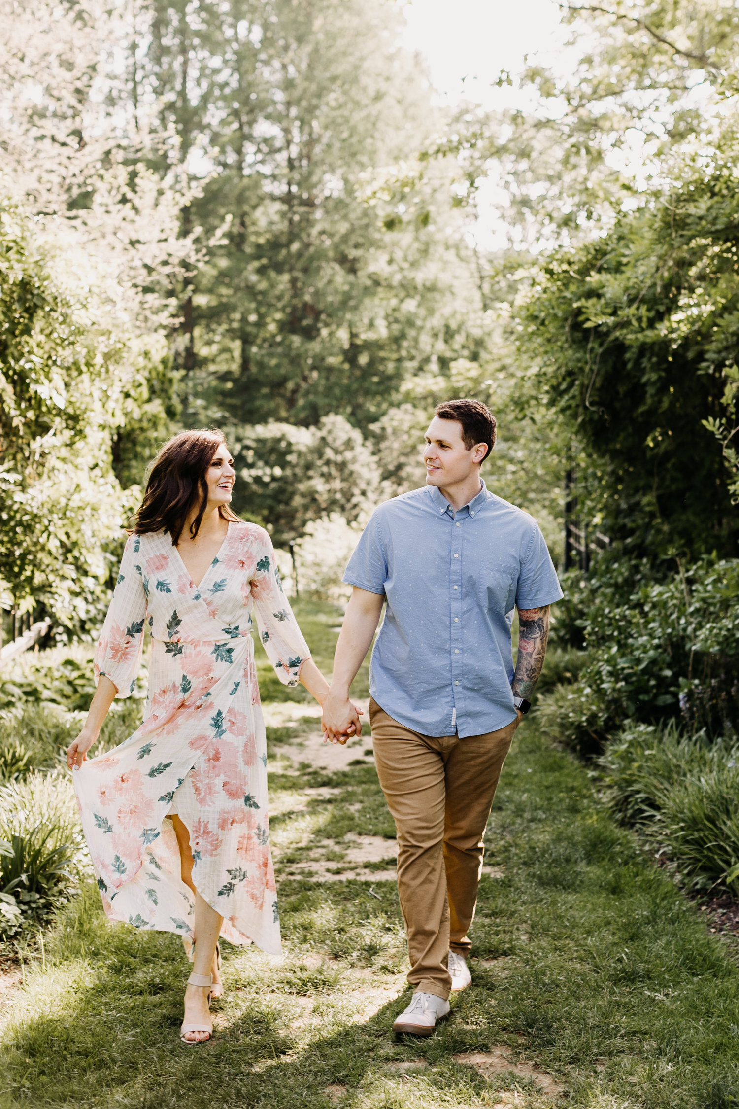 engaged couple garden flowers