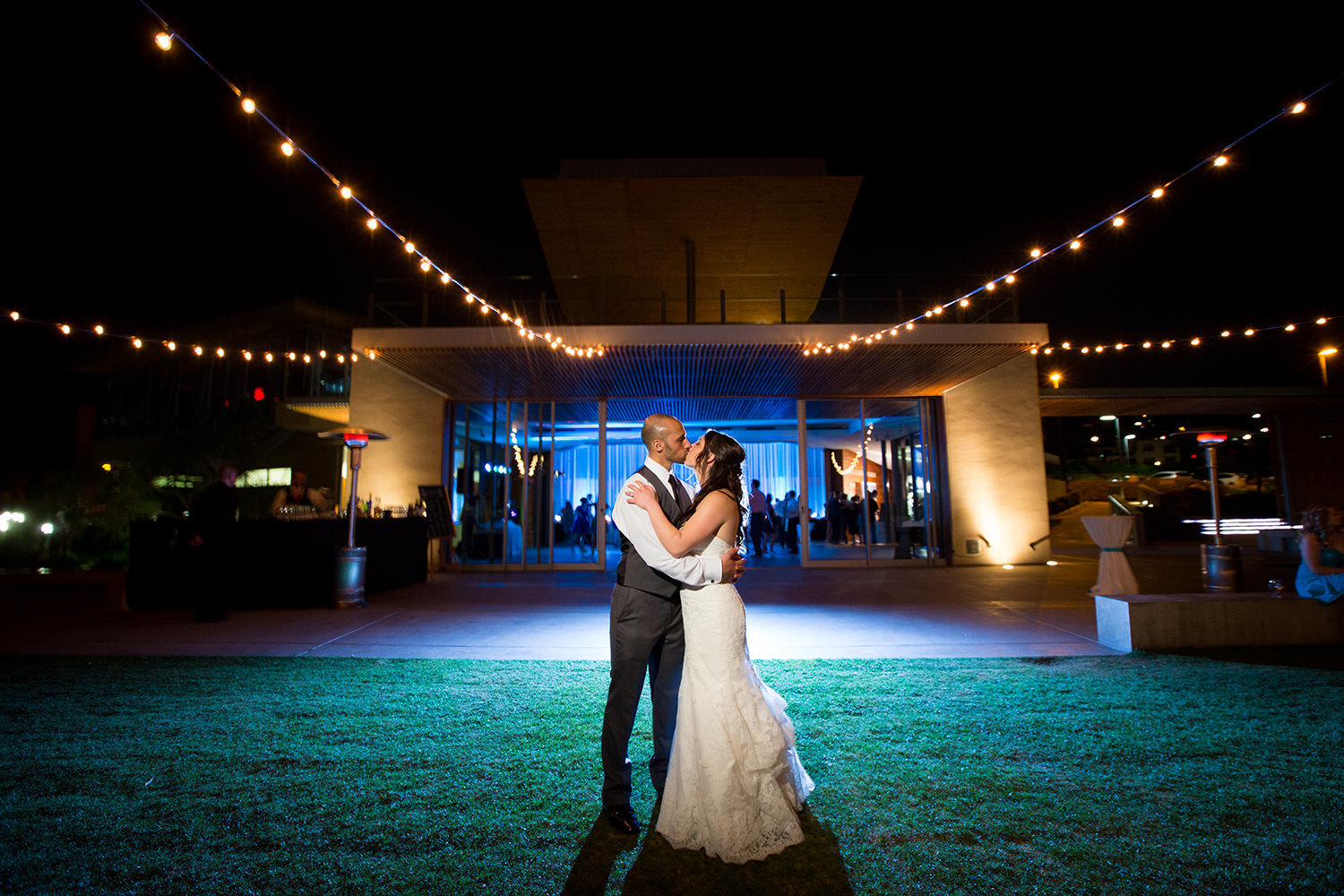 night shot with bride and groom and reception spot