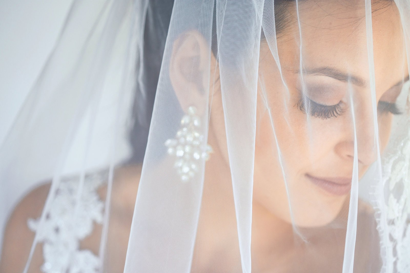 newhall mansion bride with wedding veil over face photo