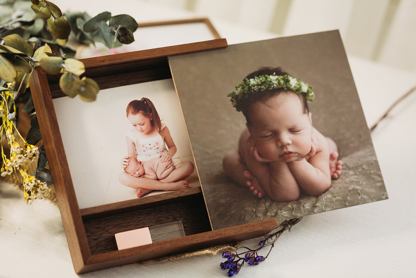 Wooden box set featuring newborn baby, containing prints and USB